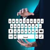 Mężczyzna pokazuje komputerowych klucze Obraz Royalty Free