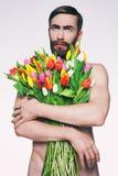 Mężczyzna portret z bukietem kwiaty Fotografia Stock