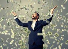 Mężczyzna pozycja pod dolara deszczem Zdjęcie Royalty Free