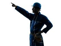 Mężczyzna pracownik budowlany wskazuje pokazywać sylwetka portret obrazy royalty free