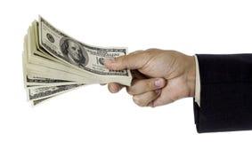 Mężczyzna ręka daje paczce dolary obrazy royalty free