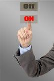 Mężczyzna ręka naciska guzika Fotografia Stock