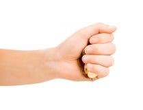 Mężczyzna ręka stawia monetę odizolowywającą zdjęcia royalty free
