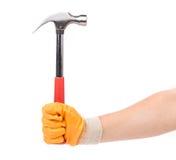 Mężczyzna ręka w rękawiczkowym mienie młocie Fotografia Royalty Free