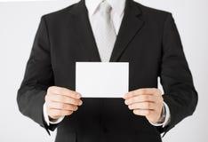 Mężczyzna ręka z pustym papierem zdjęcie stock