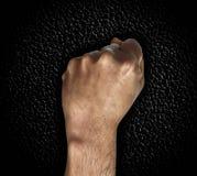 Mężczyzna ręki pięść na ciemnym tle Zdjęcia Royalty Free