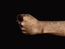 Mężczyzna ręki pięść na ciemnym tle Obrazy Stock