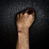 Mężczyzna ręki pięść na ciemnym tle Obraz Stock