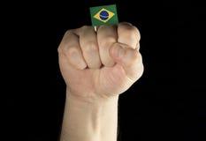 Mężczyzna ręki pięść z brazylijczyk flaga odizolowywającą na czerni Zdjęcie Royalty Free