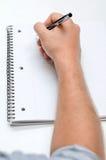 Mężczyzna ręki rysunek w notatniku Zdjęcia Stock