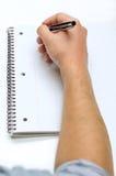 Mężczyzna ręki rysunek w notatniku Obrazy Royalty Free