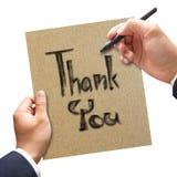 Mężczyzna ręki writing Dziękuje ciebie na papierze Zdjęcia Royalty Free