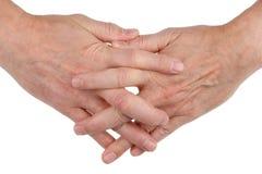 Mężczyzna ręki wyplatają wraz z palcami jako symbol frien obrazy royalty free