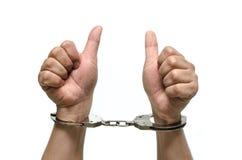 Mężczyzna ręki z kajdankami odizolowywającymi fotografia royalty free