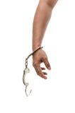 Mężczyzna ręki z kajdankami pokazuje zwycięstwo znaka obraz stock