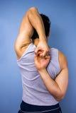 Mężczyzna rozciągania ręki za jego z powrotem Zdjęcia Royalty Free