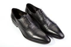 Mężczyzna ` s buty na białym tle Obrazy Royalty Free