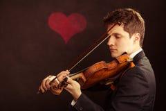 Mężczyzna skrzypaczka bawić się skrzypce. Muzyki klasycznej sztuka Obrazy Royalty Free