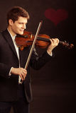 Mężczyzna skrzypaczka bawić się skrzypce. Muzyki klasycznej sztuka Obrazy Stock