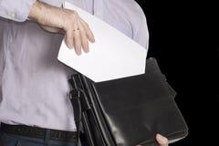 Mężczyzna stawia prześcieradło biały papier w jego teczce miejsce tekst Odizolowywa na czerni Zdjęcia Stock