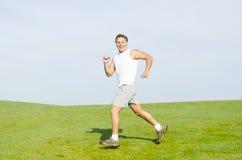 Mężczyzna szczęśliwy uśmiechnięty bieg. Zdjęcia Stock