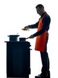 Mężczyzna szefa kuchni kulinarna sylwetka odizolowywająca Zdjęcie Royalty Free