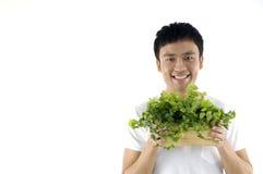 Mężczyzna target39_1_ małej doniczkowej rośliny fotografia stock