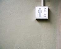 Mężczyzna toalety znak na ścianie Obraz Stock