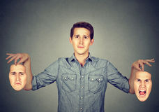 Mężczyzna trzyma dwa różnej emoci maski fotografia royalty free