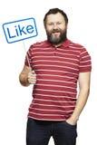 Mężczyzna trzyma ogólnospołeczni środki podpisuje uśmiecha się Zdjęcie Royalty Free
