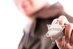 Mężczyzna trzyma szeryf odznakę Obraz Royalty Free