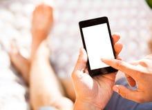 Mężczyzna używa mobilnego mądrze telefon Obrazy Royalty Free