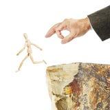 Mężczyzna ucieka od niebezpieczeństwa i skacze od skały Obraz Stock