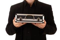 Mężczyzna utrzymuje metal skrzynkę horizontally Zdjęcia Royalty Free