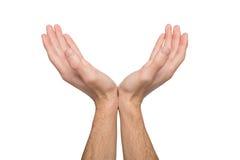Mężczyzna utrzymuje ręki w cupped kształcie, wycinanka obraz royalty free
