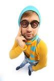 Mężczyzna w żółtym pulowerze i kombinezonach Obraz Stock