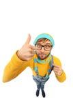 Mężczyzna w żółtym pulowerze i kombinezonach Zdjęcie Royalty Free