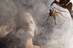 Mężczyzna w abstrakta dymu Obrazy Stock