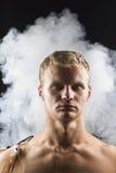 Mężczyzna w abstrakta dymu Obraz Stock