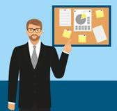Mężczyzna w biurze w kostiumu i okularach przeciwsłonecznych pokazuje na desce Zdjęcia Stock