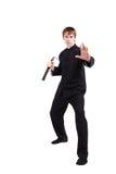 Mężczyzna w kimonowym ćwiczy kung fu z nunchaku zdjęcia royalty free