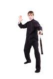 Mężczyzna w kimonowym ćwiczy kung fu z nunchaku Obraz Stock