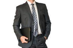 Mężczyzna w kostiumu mienia laptopie Zdjęcie Stock