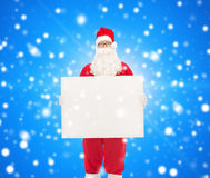 Mężczyzna w kostiumu Santa Claus z billboardem Zdjęcie Royalty Free