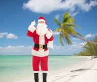 Mężczyzna w kostiumu wskazuje palec up Santa Claus Zdjęcie Royalty Free