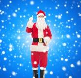 Mężczyzna w kostiumu wskazuje palec up Santa Claus Obrazy Stock
