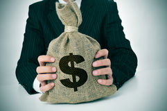 Mężczyzna w kostiumu z burlap pieniądze torbą Obraz Stock