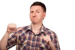 Mężczyzna w szkockiej kraty koszula pokazuje kciuki do on Obrazy Royalty Free