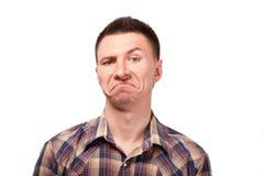 Mężczyzna w szkockiej kraty koszula z śmiesznymi twarzy wyrażeniami Obraz Stock