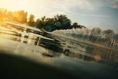 Mężczyzna wodny narciarstwo przy zmierzchem Obraz Royalty Free